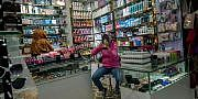 URUMQI, XINJIANG UYGUR AUTONOMOUS REGION, CHINA - 2016/06/18: A Uygur woman is choosing cosmetic in a beauty goods shop. The Xinjiang International Grand Bazaar, an Islamic bazaar in Ürümqi, is the largest bazaar in the world by scale and one of the most famous landmarks in this city. (Photo by Zhang Peng/LightRocket via Getty Images)