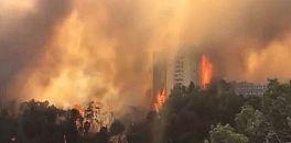 بالفيديو… نيران جهنمية تلتهم عمارات كاملة باسرائيل